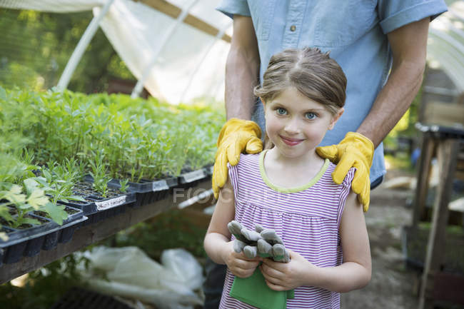 Man and child with gardening gloves — Stock Photo
