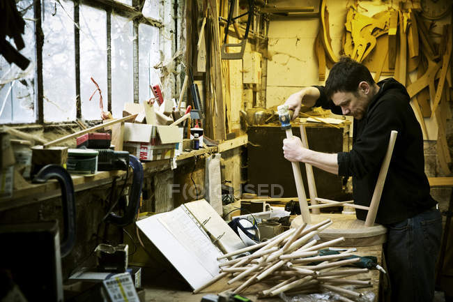 Man working in a furniture maker's workshop — Stock Photo