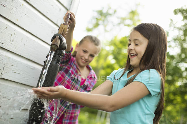 Girls washing their hands — Stock Photo
