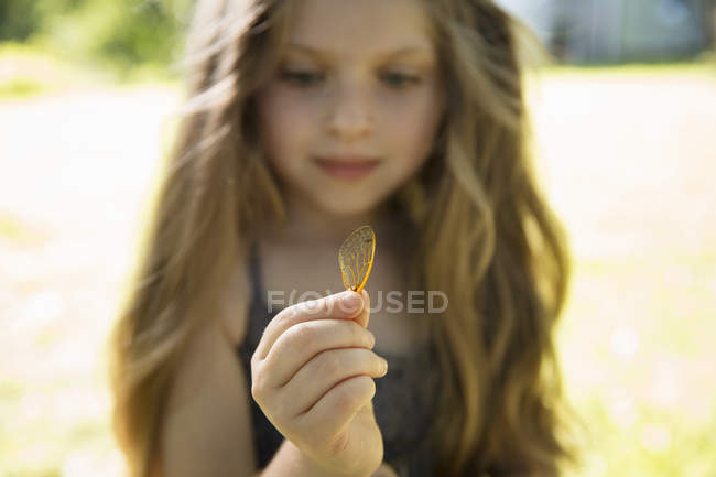 Girl holding delicate lacey — Stock Photo