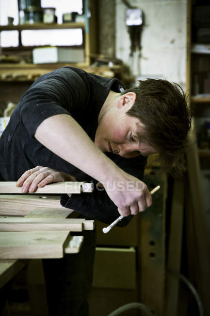 Woman working in a furniture maker's workshop — Stock Photo