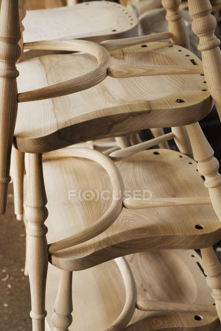 Stack of wooden chairs — Stock Photo