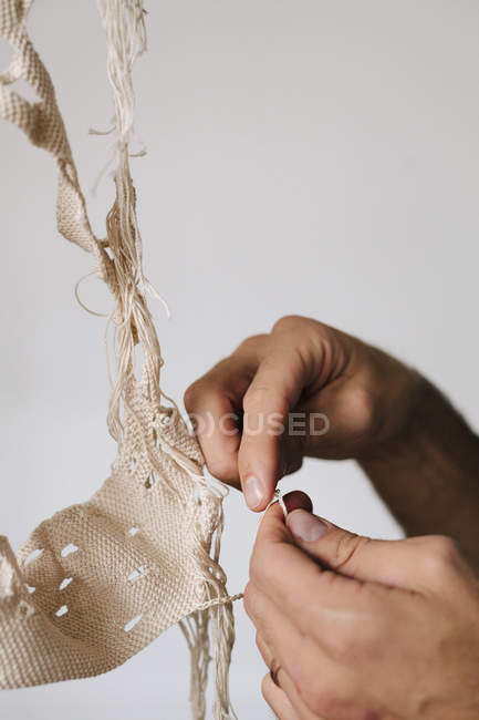 Male artist creating object with thread. — Stock Photo