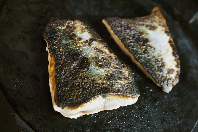 Fillet of fish with crispy skin. — Stock Photo