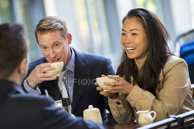 Group of people sitting in coffee shop — Stock Photo