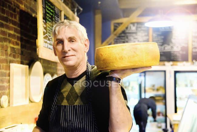 Artisan cheese maker — Stock Photo