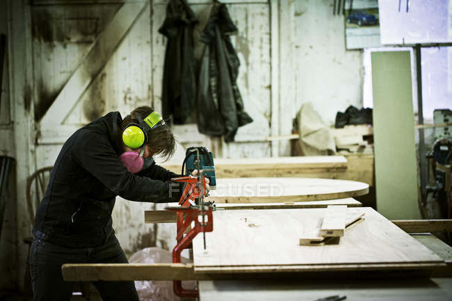 Woman working in a furniture workshop. — Foto stock