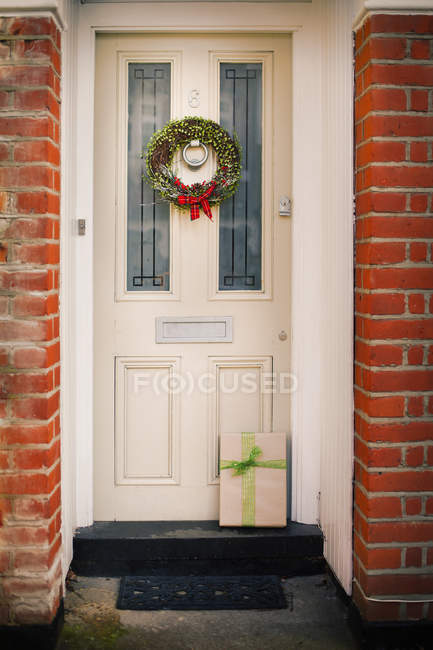 Christmas wreath on the front door — Stock Photo