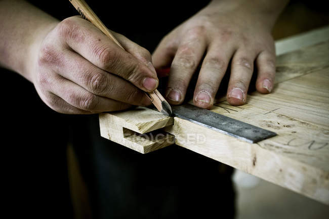 Man working on wood — Stock Photo