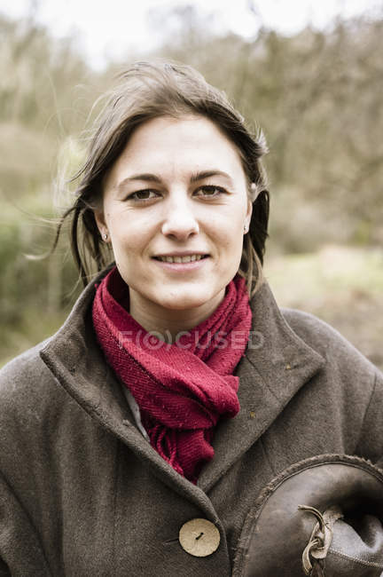 Woman in scarf looking at camera — Stock Photo