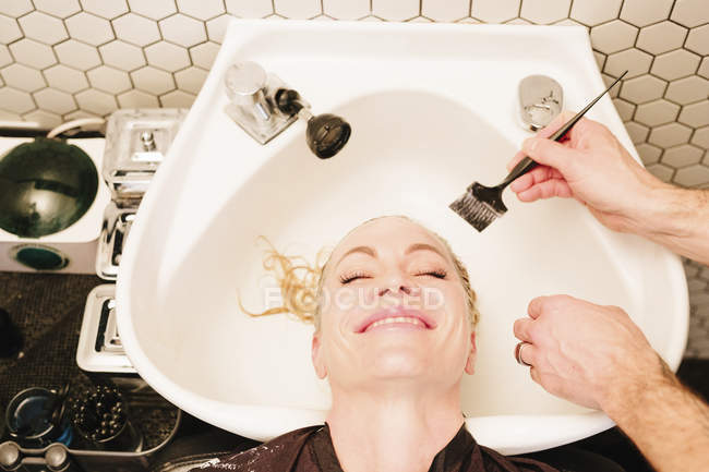 Female client having hair treatment — Stock Photo