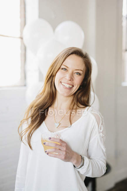Woman holding drink in glass — Stock Photo