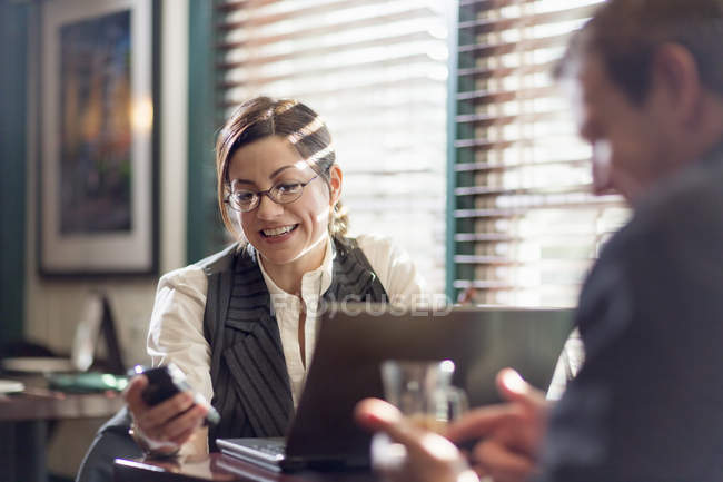 Woman and man sitting at desks and working — Stock Photo