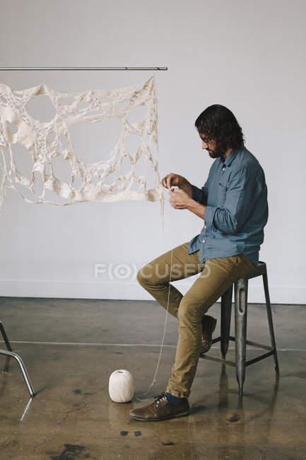 Artist working on an art piece — Stock Photo
