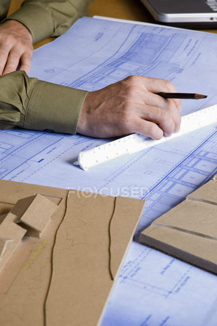 Architect working on a blue print. — Stock Photo
