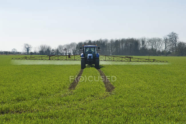 Tractor and crop-sprayer — Stock Photo