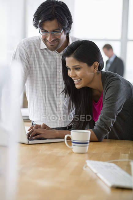 Man and woman using laptop computer — Stock Photo