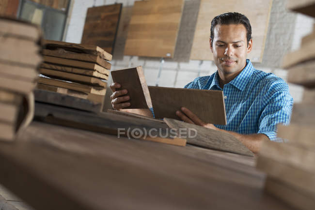 Young man in workshop — Stock Photo