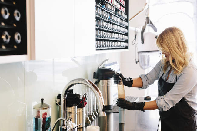 Woman working wearing gloves — Stock Photo