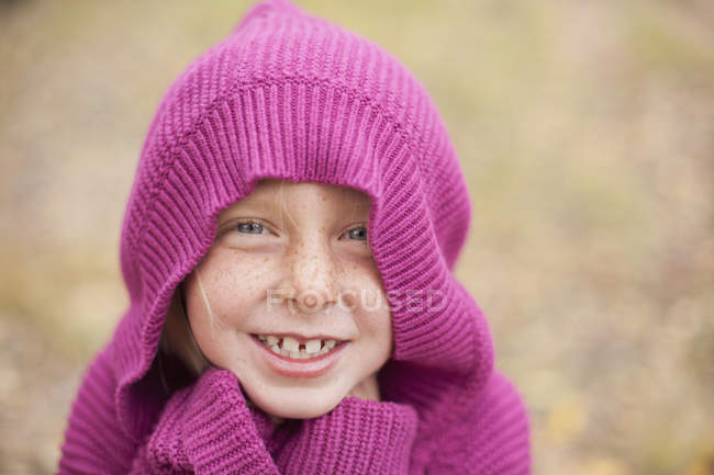 Girl in magenta hooded sweater — Stock Photo