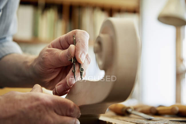 Violin maker working in workshop — Stock Photo
