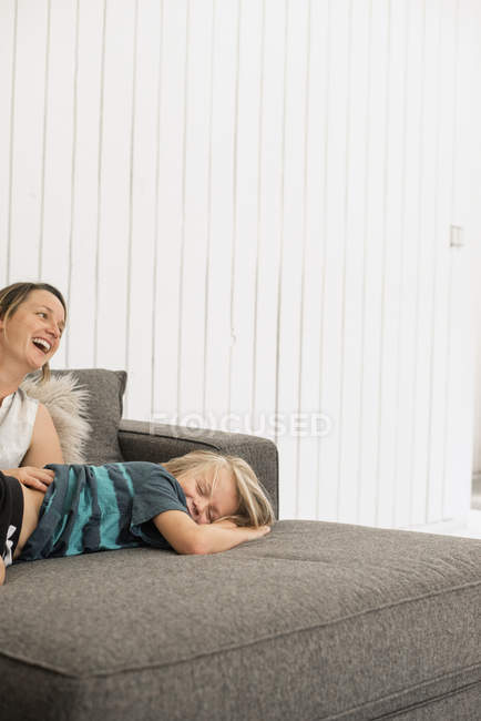 Mother and son lying on sofa — Stock Photo
