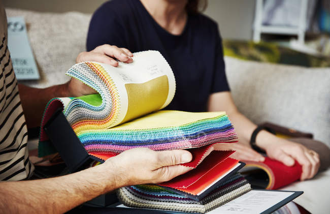 People looking at selection of fabric samples — Stock Photo