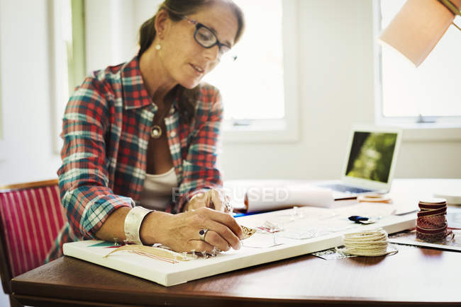 Woman making a collage picture. — Stock Photo