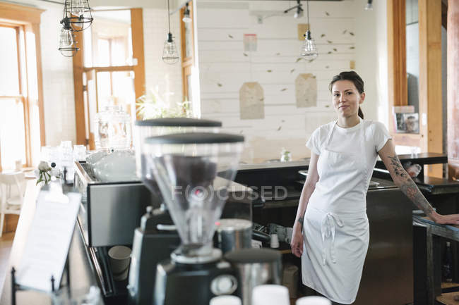 Woman in a coffee shop — Stock Photo