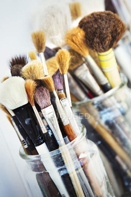 Two jars with bristle brushes — Stock Photo