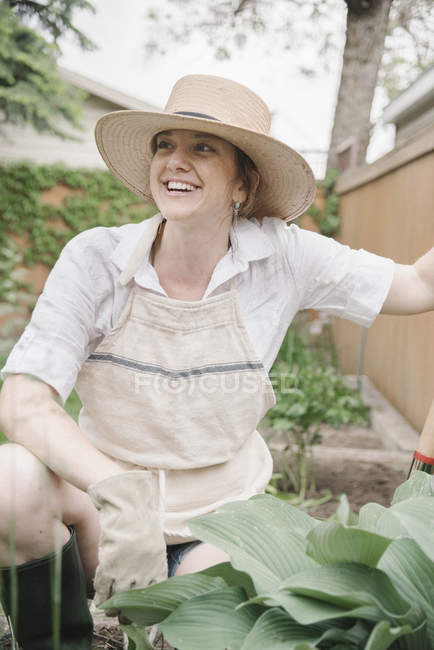 Woman working in a garden — Stock Photo