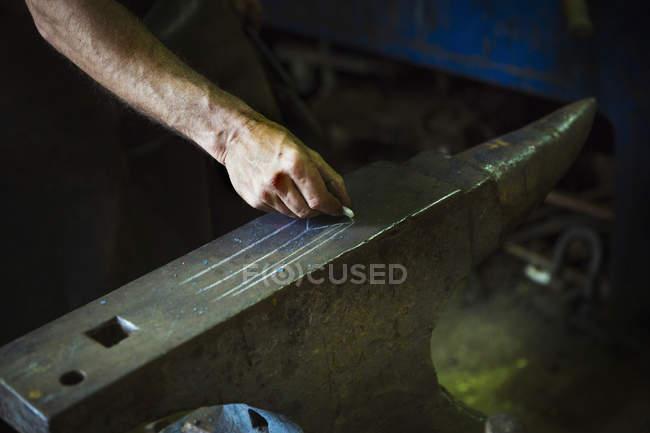 Blacksmith draws a design — Stock Photo