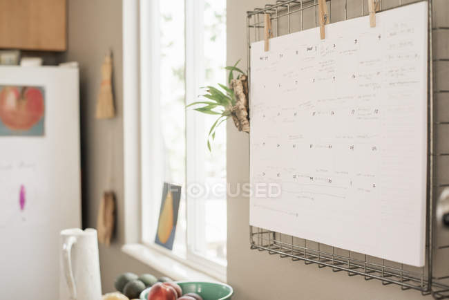 Wall planner on wall — Stock Photo