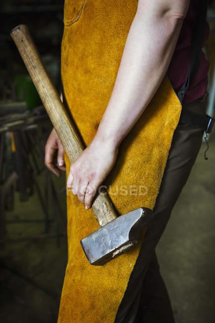 Blacksmith holding a large hammer. — Stock Photo