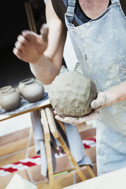 Potter handling a ball of clay — Stock Photo