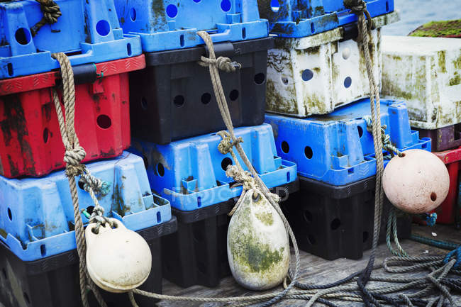 Fish boxes and fishing floats. — Stock Photo