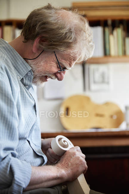 Violin maker using hand tools — Stock Photo