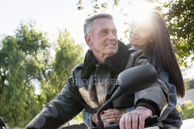 Senior couple taking a ride on a motorcycle — Stock Photo
