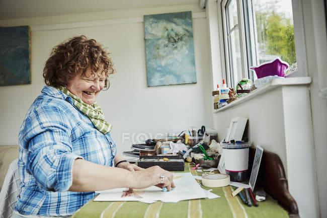 Woman using pastel crayon and drawing — Stock Photo
