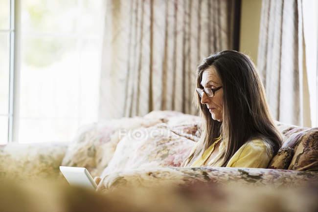 Senior woman using digital tablet. — Stock Photo