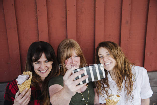 Women taking a selfie with ice cream — Stock Photo