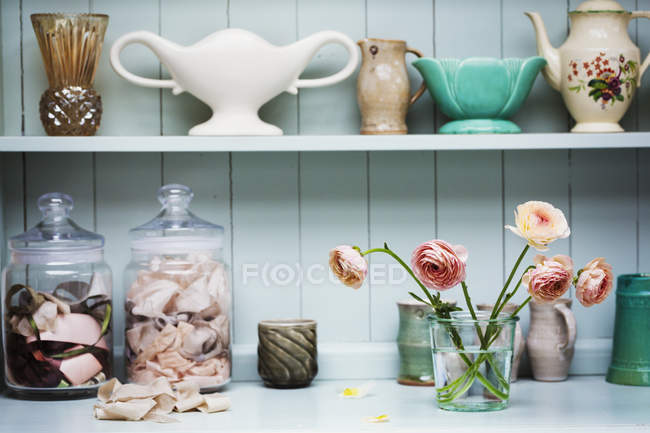 Shelf with vases and ceramic pots — Stock Photo