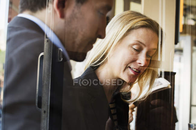 Businesswoman and businessman at meeting — Stock Photo