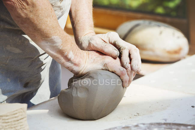Potter preparing a lump of damp clay — Stock Photo