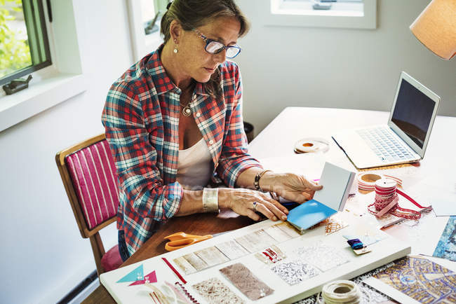 Woman creating a collage picture — Stock Photo