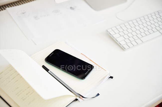 Desk with a computer and white keyboard — Stock Photo