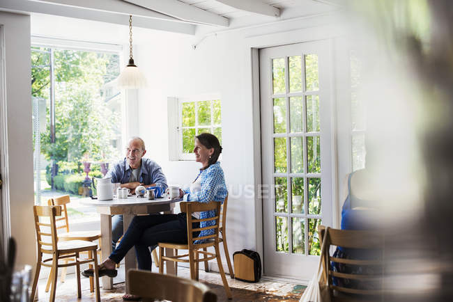 People seated in coffee shop — Stock Photo