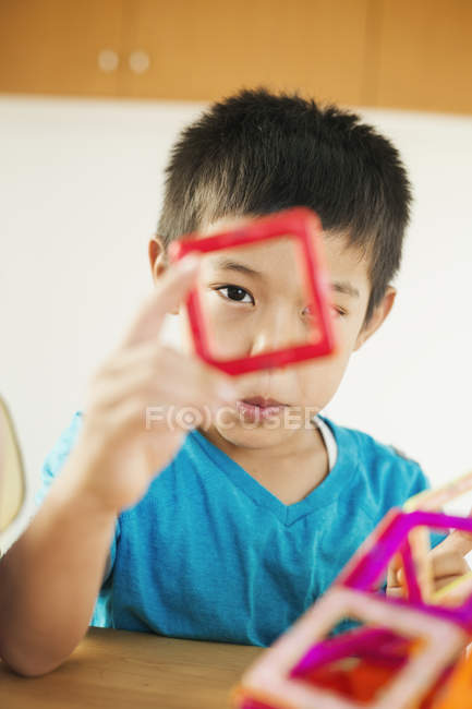 Boy playing with geometric shapes. — Stock Photo