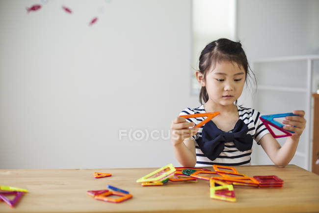 Girl playing with geometric shapes. — Stock Photo