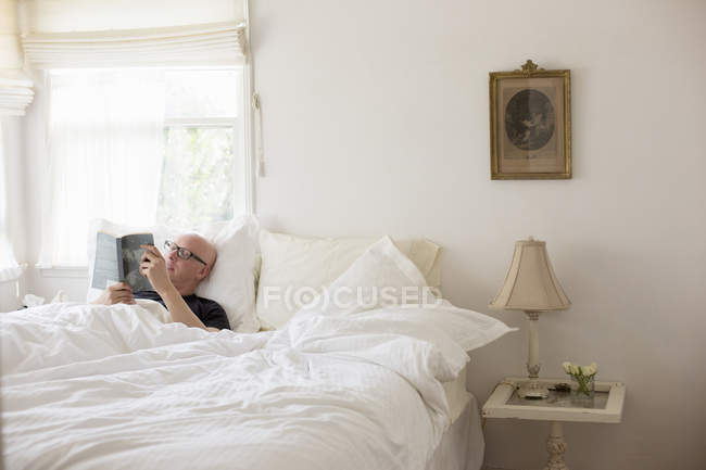 Man lying in a bed — Stock Photo